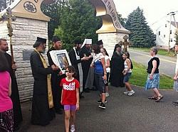 Met Jonah, Abp Tikhon & Abbot Sergius greet the faithful at the Monastery entrance.